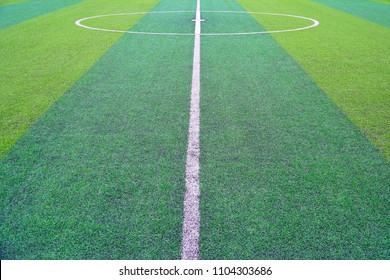 Front view of green soccer field.Beautiful artificial grass on the stadium.Abstract football turf ground background with white stripe line.Background,Sport,Texture Concept