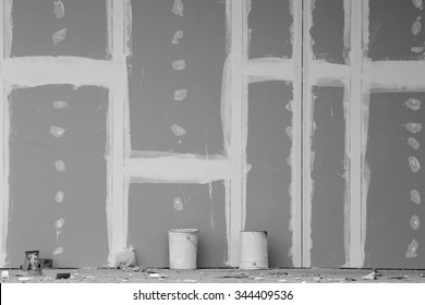 Front view of gypsum wall with joints at building site. Black and white image