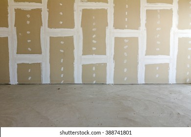Front view of gypsum wall with joints at building site
