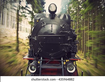 Front View Of A Historic German Black Steam Powered Railway Train In Motion Blur National