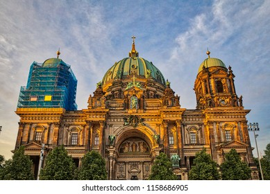 Front view of the historical Berlin Cathedral at sunset, located on the museum island in center of Berlin, Germany, with one dome in renovation.