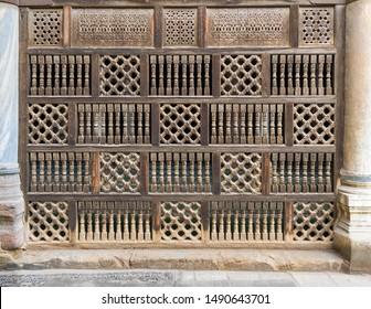 Front view of interleaved wooden arabisk wall - Mashrabiya, Facade of public historic mosque of Amir Al-Maridani, Cairo, Egypt