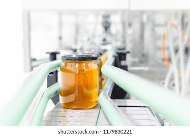 Front view of jar full with honey in factory.