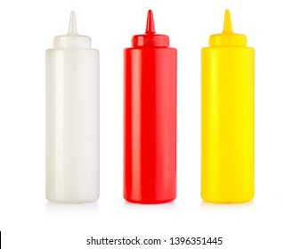 front view of ketchup mayonnaise and mustard blank plastic bottles isolated on white