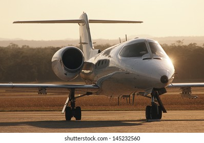 Front view Lear jet on tarmac