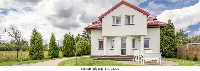 Front view of little elegant house with red roof