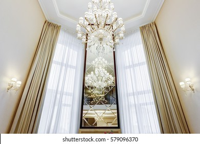 Chandeliers imgenes pagas y sin cargo y vectores en stock front view of long mirror between windows with luxury curtains interior in brown beige aloadofball Gallery