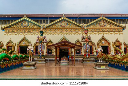 Front view to the main entrance of Wat Chayamangkalaram Temple - Statues standing outside, Georgetown, Penang, Malaysia.