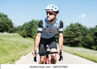 Front view of men cycling mountain road at morning. Sport concept