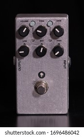 Front view of metallic overdrive effect for guitar on black background