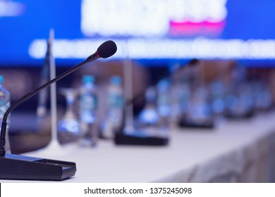 Front view of the microphones during business conference in conference room or hall, panel duscusion of economic development
