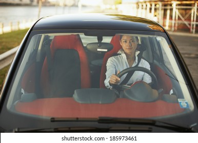 Front View of Mid-Adult Woman Driving Microcar
