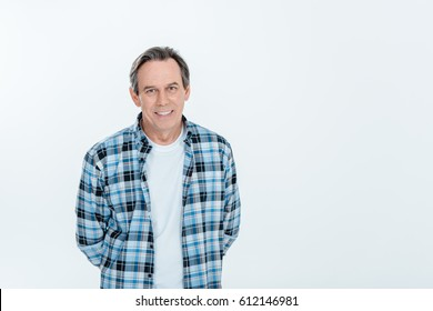 Front view of middle aged handsome man smiling  isolated on white with copy space