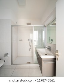 Front view modern bathroom with shower and sink. Nobody inside