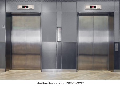 Front view of modern elevator with closed doors in lobby