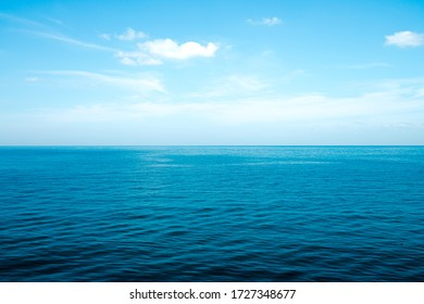 The front view in the morning sky is bright blue with clear white clouds. And the ocean deep indigo in daylight. Feeling calm, cool, relaxing. The idea for cold background and copy space on the top.