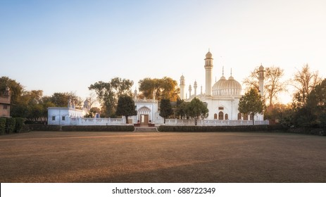 Front view of a mosque in Peshawar basking in golden evening light.
