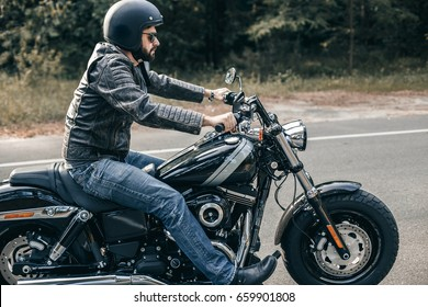 Front view of motorcycle driver driving in beautiful sunset. Freedom and travel concept.