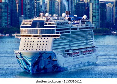 Front view of NCL Norwegian Bliss anchored in Vancover harbour. Vancouver city in the background. Vancouver, BC/Canada/September 30th 2019