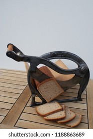 Front view of a nostalgic bread slicer with cutting bread -