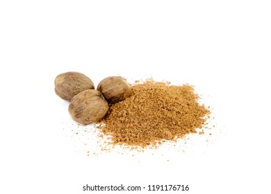Front view of nutmeg seed and ground nutmeg on white background, isolated. Nutmeg. The concept of seasoning dishes, using spices and herbs for meals.
