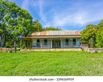 A front view of an old abandoned farm house