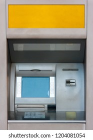 Front view of an old automated teller machine with a large copy space at the top