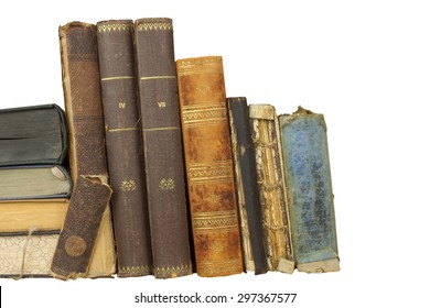 Front view of old books stacked on a shelf. Books without title and author. Isolated on white background, place for your text
