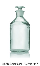 Front view of old empty pharmacy medical bottle with glass stopper isolated on white