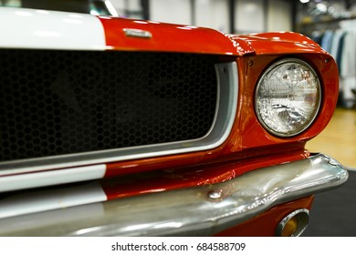 Front view of a old retro car. Car exterior details. Headlight of a vintage retro car. The front lights of the car