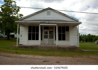 A front view of an old white building.