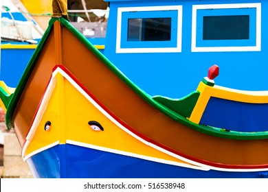 Front view on a traditional yellow-blue maltese fisherman boat.