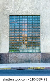 Front view of one large mosaic window on a city building.