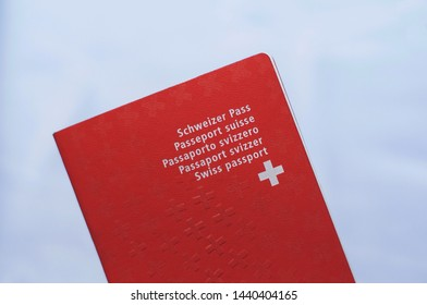 Front view of one Swiss passport with white background