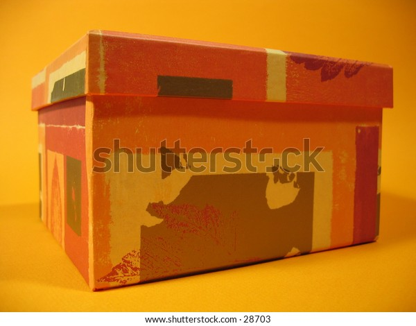 Front view of an orange colored box.