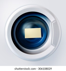 Front view and portion of the porthole of the washing machine during washing and rotation of the drum containing clothes blue with sticky note.