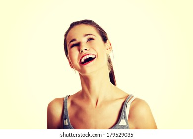 Front view portrait of a smiling young female caucasian teen looking up, on white.