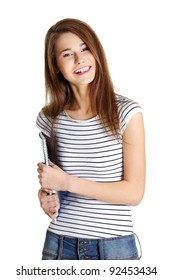 Front view portrait young happy female caucasian student holding a notebook, on white.