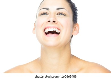 Front view of pretty woman laughing on white background