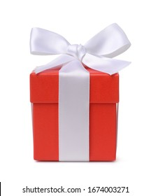 Front view of red gift box with white ribbon isolated on white