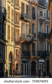 Front view of residential buildings architecture in Bordeaux with morning light, vintage style