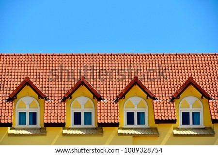 east coast windows front view of row dormer windows on the tiled roof townhouse against view row dormer windows on stock photo edit now 1089328754