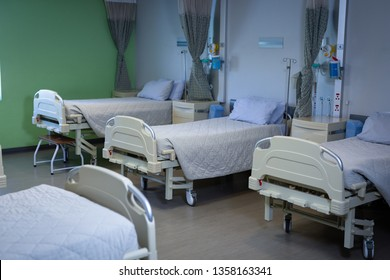 Front view of row of empty hospital beds in a hospital