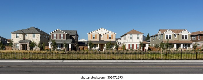 A front view of a row of new houses.
