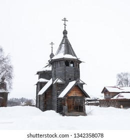 Front view of a russian wooden church in snow