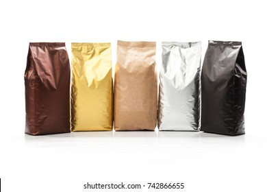 Front view of set of blank paper bags for tea, coffee and grain packaging. Retail shopping and advertising concept. Isolated on a white background. Detailed closeup studio shot