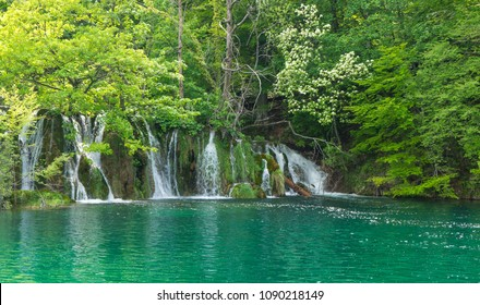 Front view of small waterfalls running into the lake in Plitvice Lakes National Park in Croatia