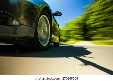 Front view of speeding car.