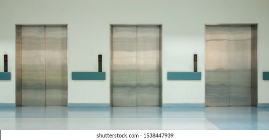 Front View of Three Doors in Elevator with Closed Doors