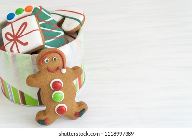 Front View of Tin of Christmas Gingerbread Cookies Horizontal with Copy Space Top on Light Background